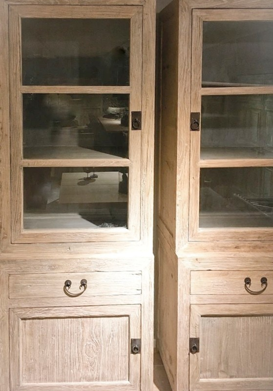 Display Case Of Natural Wood Cabinets